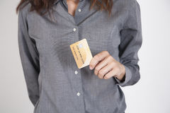 Grey shirt woman with credit card Royalty Free Stock Photo