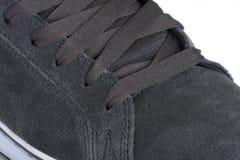 Grey shoe close-up Stock Images