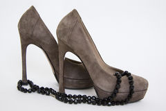 Grey shoes and black beads Royalty Free Stock Photography