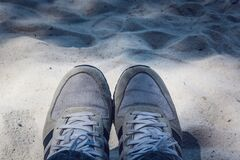 Grey Shoes on Top of Grey Sand Stock Image