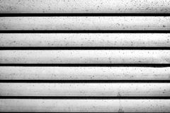 Grey shutters over a shop doors Royalty Free Stock Photos