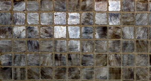 Grey, Silver and Brown Ceramic Tile Background. A background shot shows grey, silver and brown tiles Royalty Free Stock Image