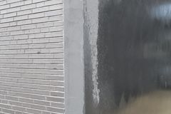 Grey textured concrete background with brick wall Royalty Free Stock Photography
