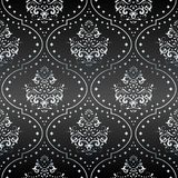 Grey and silver victorian pattern. Victorian pattern with detailed silver-leaf design on anthracite gradient background. Graphics are grouped and in several royalty free illustration