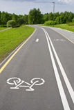 Grey sinuous bicycle. Path in the park Royalty Free Stock Image