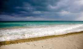 Grey sky in cuba. Exotic beach over blue sea and grey sky Royalty Free Stock Photography