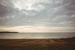 Grey sky over expansive ocean Royalty Free Stock Photography