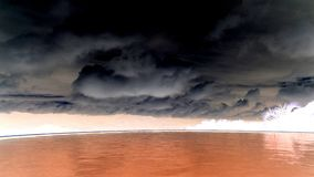 Grey sky on red water. Here one painting photo of contrast. Red water against grey sky stock photos