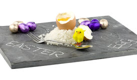 A grey slate with easter decorations Royalty Free Stock Photography