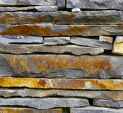 Grey Slate Wall Background. Close-up detail of grey slate stone wall stock photography