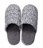 Grey slippers with flower print isolated on white background. Close up, high resolution Royalty Free Stock Photo