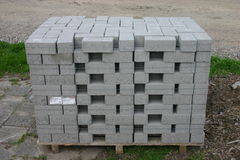 Grey small building blocks or plates. Close-up of new small building blocks or plates sorted in stacks stock image