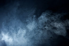 Grey Smoke azul no fundo preto Foto de Stock Royalty Free