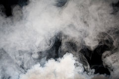 Grey smoke with black background Stock Images