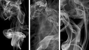 Grey smokes on black background Royalty Free Stock Photo