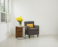 Grey sofa armchair in simple setting Stock Photos