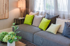 Grey sofa and green pillows in living room Royalty Free Stock Image