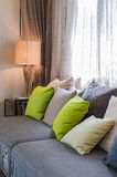 Grey sofa with green pillows in living room Royalty Free Stock Photography