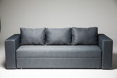 Grey sofa isolated on grey background stock photo