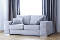 Grey sofa Royalty Free Stock Images