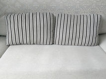 Grey sofa and pillow as furniture background Royalty Free Stock Image