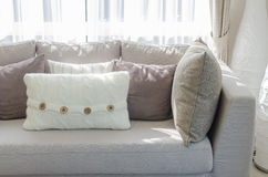 Grey sofa with pillows in luxury living room Stock Photography