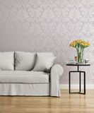 Grey sofa with a purple damask victorian wallpaper. Rendering of a Grey sofa with a purple damask victorian wallpaper royalty free stock photos