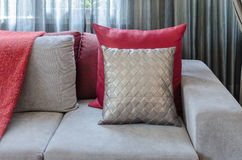 Grey sofa with red pillow in living room at home Stock Photography