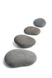 Grey spa stones isolated Royalty Free Stock Photos