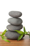 Grey spa stones and leaves isolated Royalty Free Stock Photos