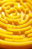 Grey sphere in golden labyrinth Stock Images
