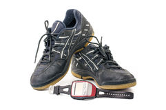 Grey sport shoes with stopwatch Royalty Free Stock Image
