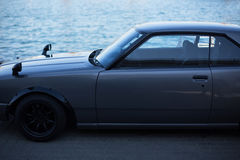 Grey sports coupe. Classic japanese car stock photos