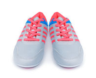 Grey sports shoes with pink shoelaces Royalty Free Stock Photos
