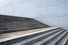 Grey stairs in front of a wall Royalty Free Stock Photography
