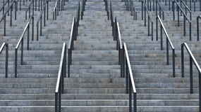 Grey stairs. High stairs with handrails near it stock photos