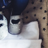 Grey stars tiny baby shoes close up Royalty Free Stock Images