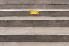 Grey steps with Beware sign. Stock Photo