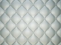 Grey stitched leather pattern with buttons and bumps. Luxury background Stock Photos
