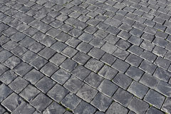 Grey stone cobblestone background paving Royalty Free Stock Photos