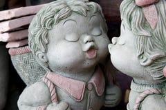 Grey stone dolls. Pretty grey stone dolls in love royalty free stock photo