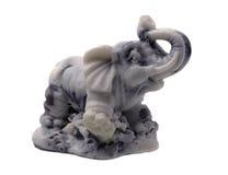Grey Stone Elephant Figurine på vit arkivbild