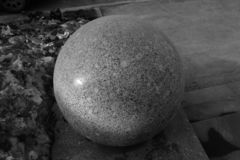 Grey stone sphere royalty free stock photos