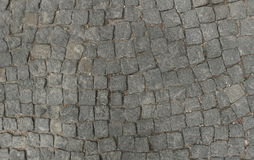 Grey stone road. Old grey stone road surface Royalty Free Stock Photography