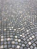 Grey stone road. Grey tiled stone road background Royalty Free Stock Photos
