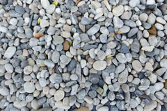 Grey Stone rubble rock close up texture, seamless background Stock Image
