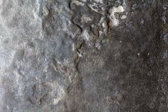 Grey stone texture photo. Natural stone background. Weathered rock relief. Uneven sandstone surface. Closeup. Distressed stone texture. Solid construction stock images