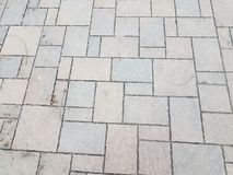 Grey stone tiles on the ground or tessellation or background. Grey stone or rock tiles on the ground or tessellation or background royalty free stock images