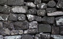 Grey stone wall background or wallpaper. Rough grey stone bricks design. Stock Image