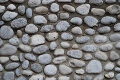 Grey stone wall backgrounds Stock Photography